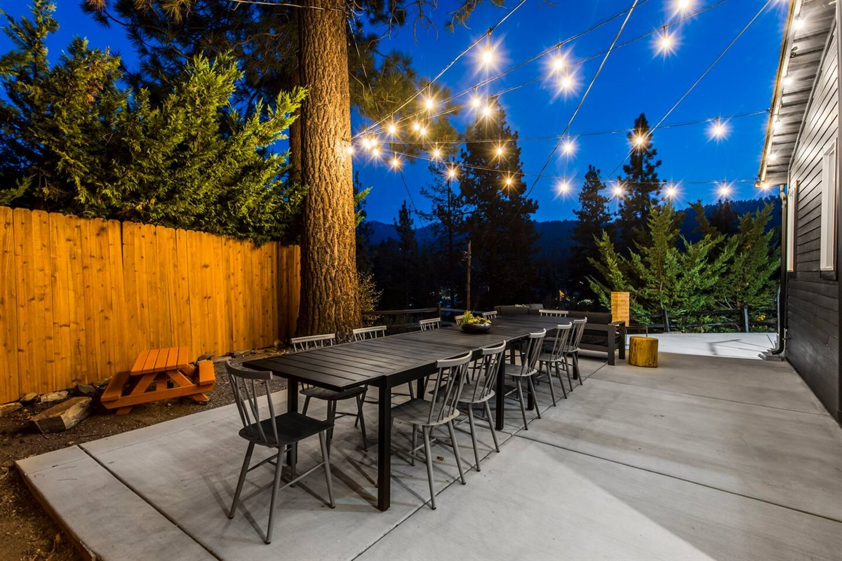 Spacious outdoor dining table on back deck for 10+ people with incredible mountain views!