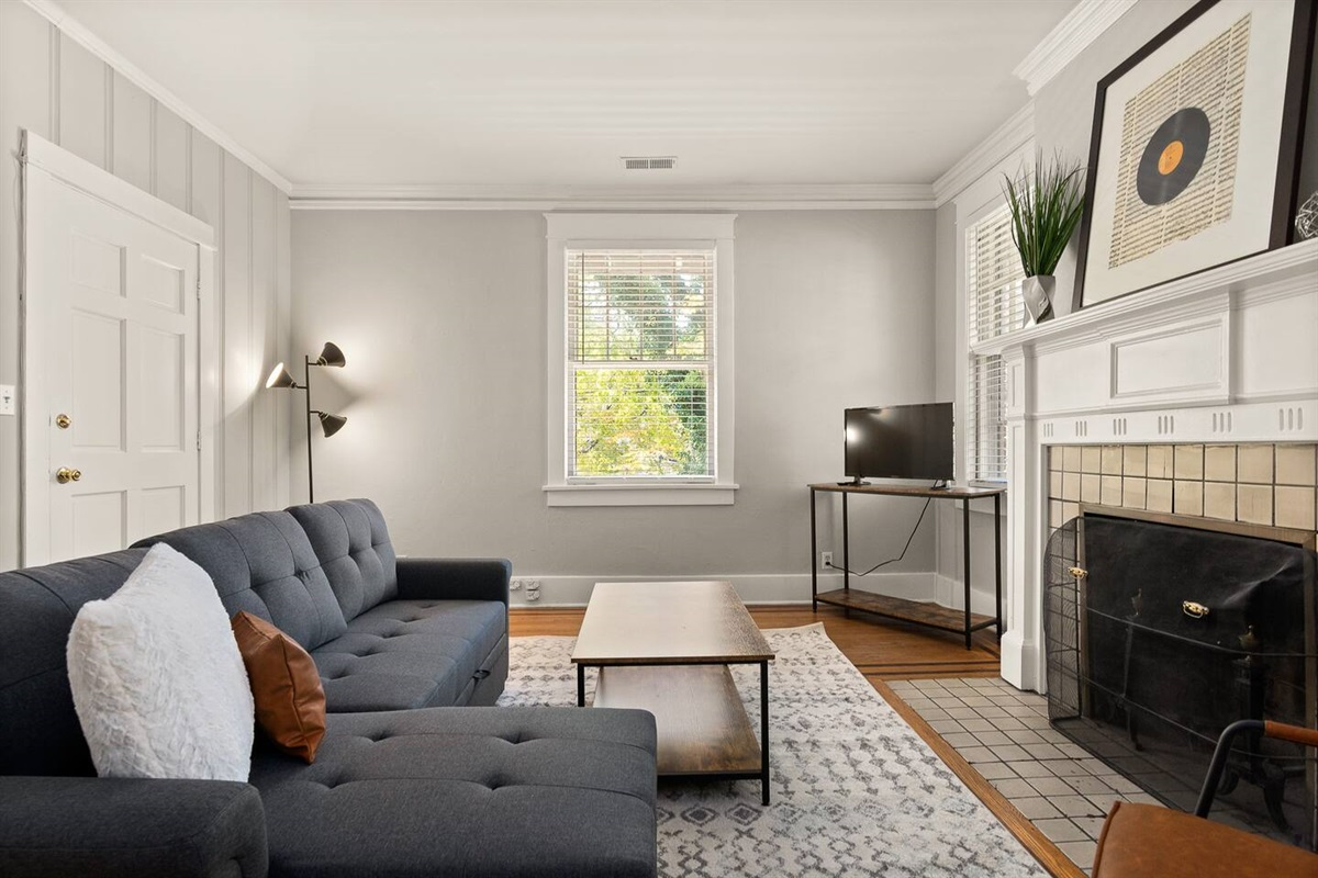 Comfortable living room for you to sit back and relax during your trip.  Netflix and internet provided! Couch pulls out to an additional bed for extra guests!