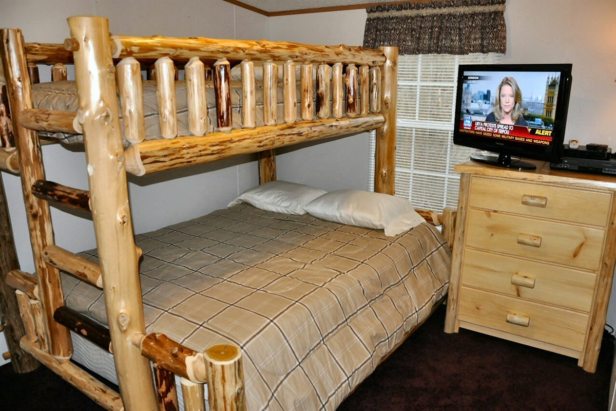 2nd bedroom with queen and twin beds & HDTV