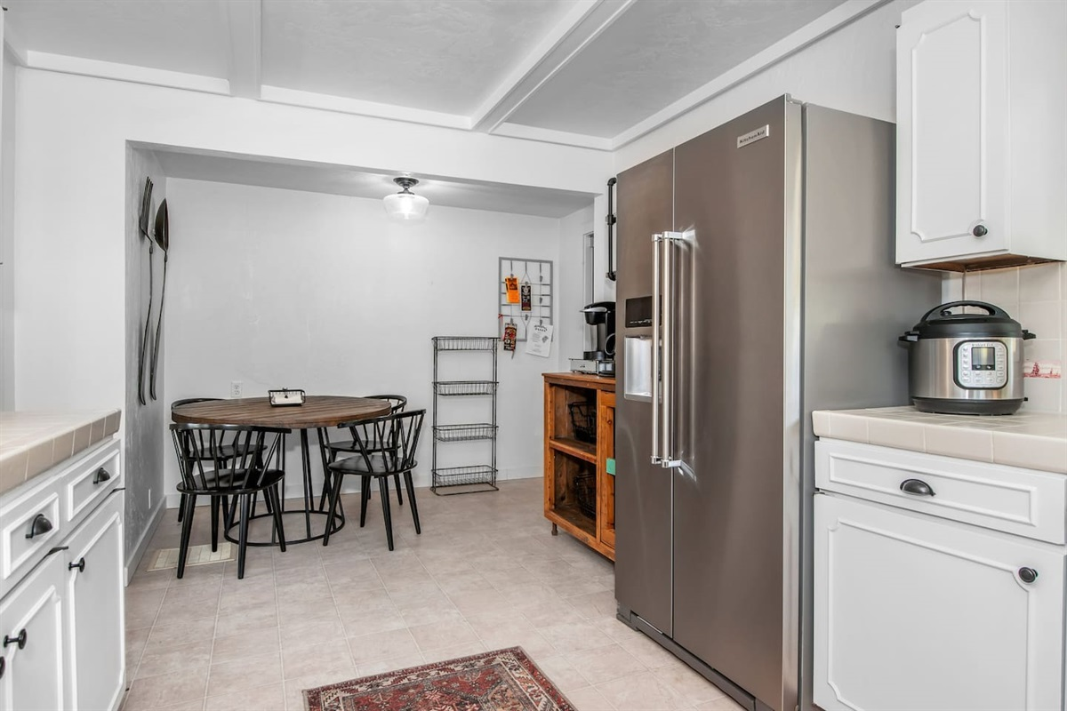 Kitchen (Lower Level): Kitchen area with all new Kitchen Aid appliances and small dining area / breakfast nook.