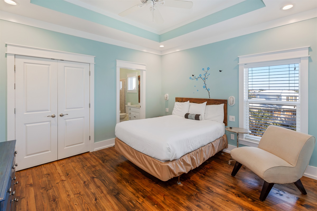 Third floor queen suite with private bath has plenty of natural light and great views of the Gulf right from bed!