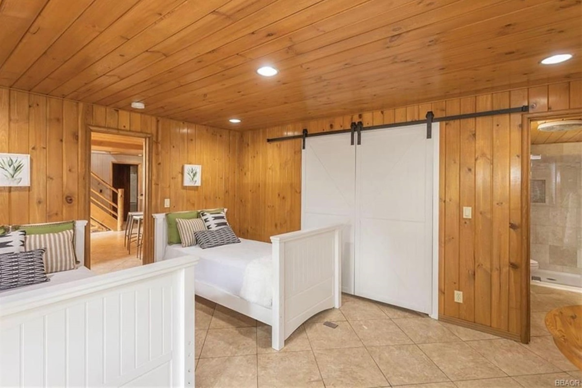 Bedroom #4 (Lower Level): It features 2 twin beds, closet, and ensuite bathroom with shower.