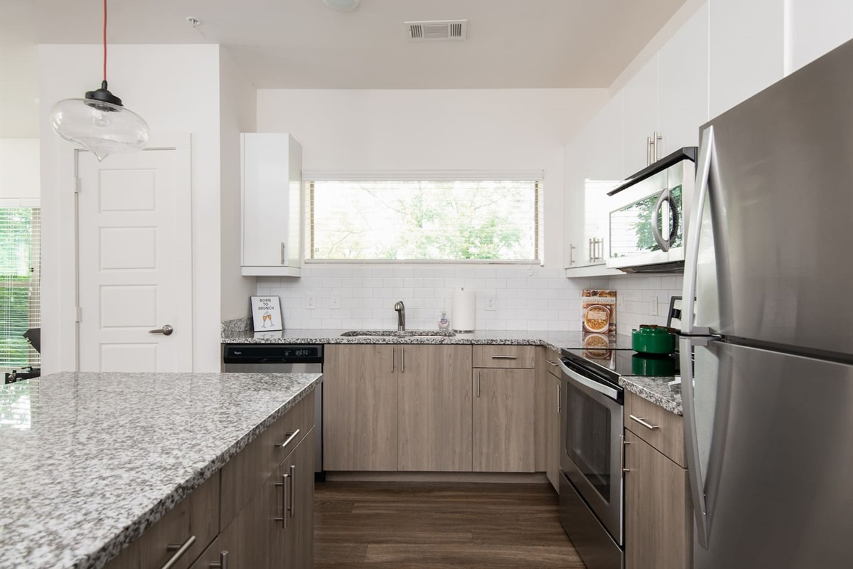 New kitchen with high ceilings, granite countertops and plenty of storage. All the amenities included you could need if you choose to dine in. Free coffee/sugar/creamer!