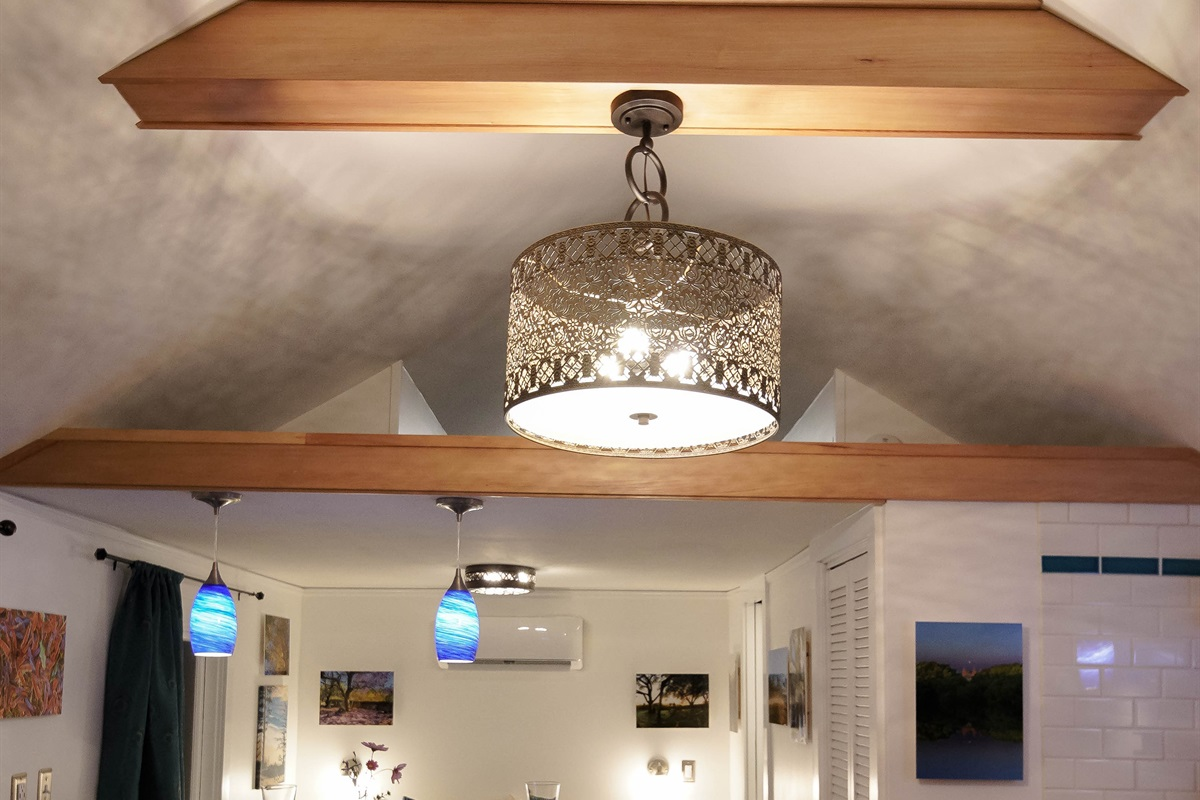 Ceiling fixture throws patterns onto the high ceiling.
