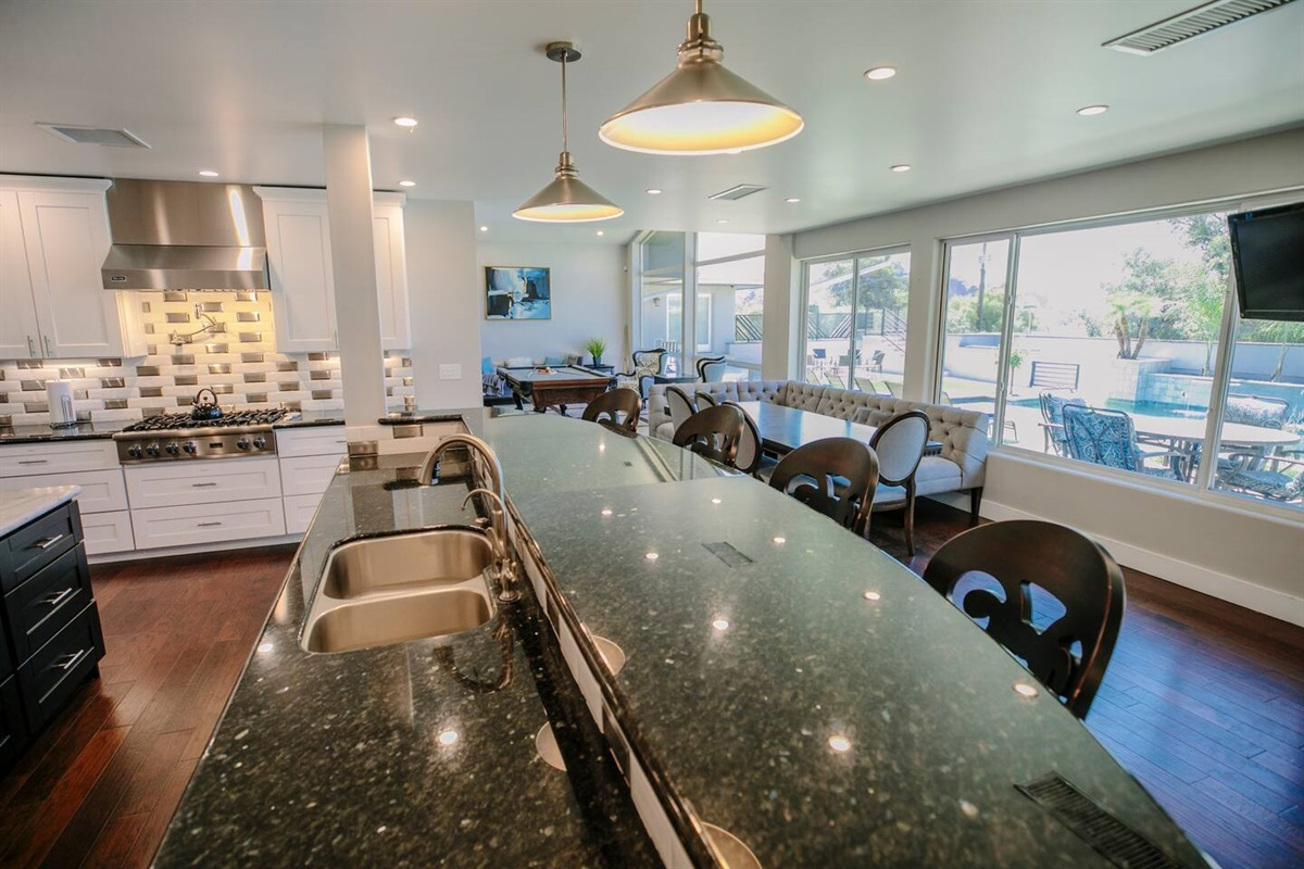 Gather around with friends and family in large kitchen overlooking fabulous backyard!