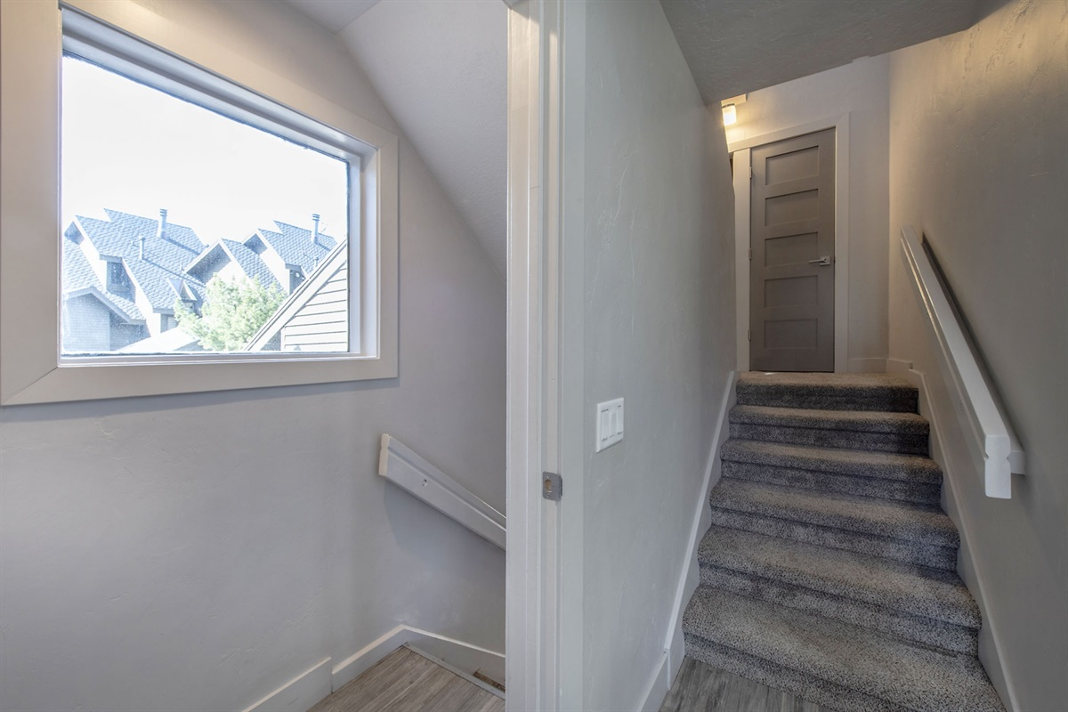 Stairs to upper level (bonus room and Family suite)