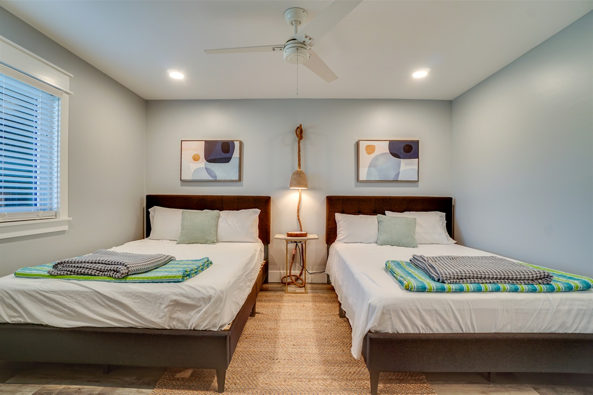 Guest room on main level with 2 queen beds