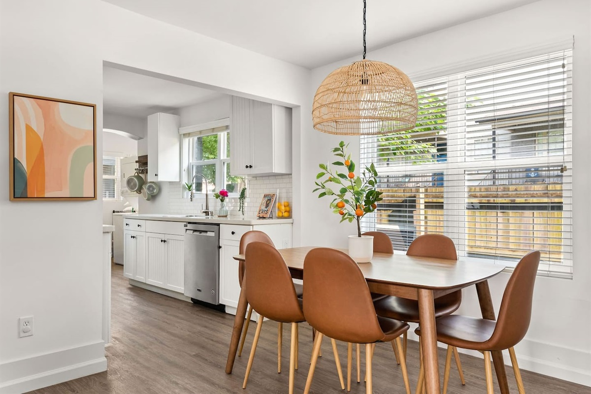 Heading on from the living room, you'll find the dining area with seating for 6