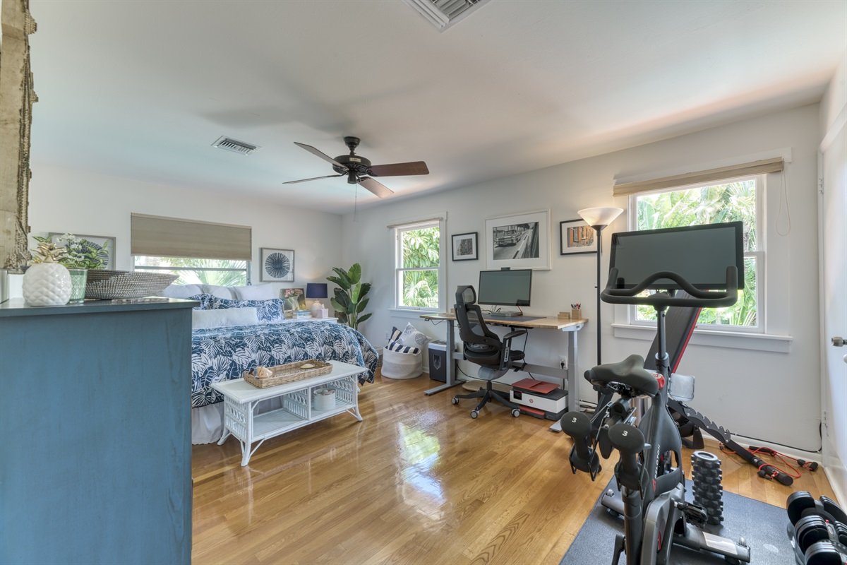 1 Bedroom upstairs in the Guest House. King size bed with adujstable sitting or standing desk and chair. Peleton Bike, weight bench and weights. (Guests to provide own Peletone login account info & cleets/ shoes)