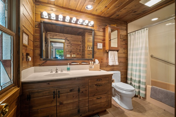 The full bathroom features a heater just outside the shower.
