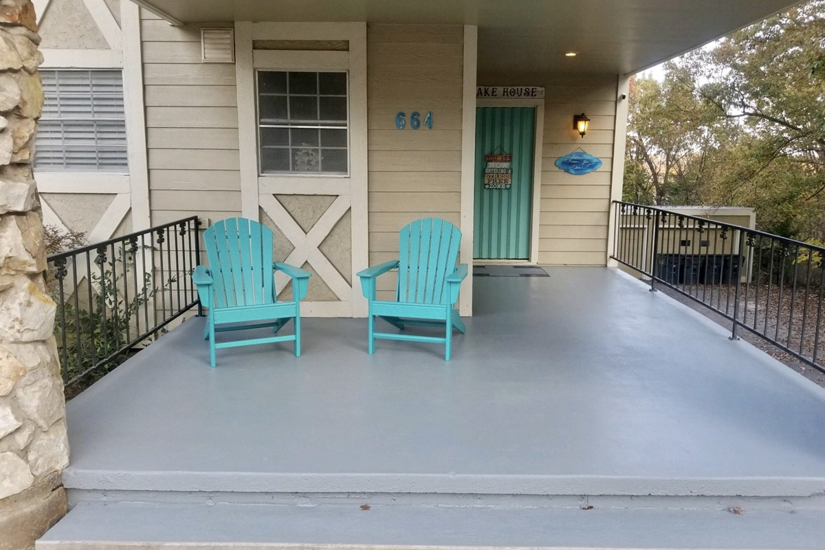 Covered front porch with 2 Adirondack chairs great for coffee in the mornings.