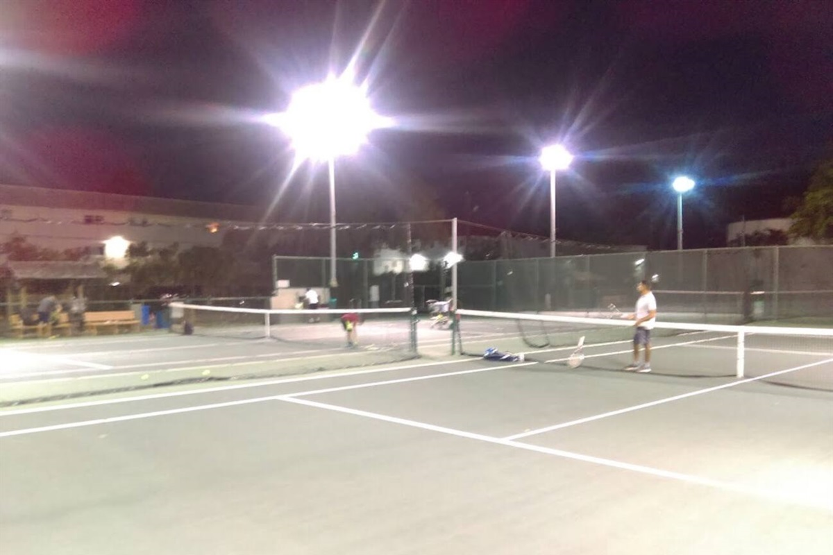 The Jefferson Park tennis courts, one of many public courts located minutes away.