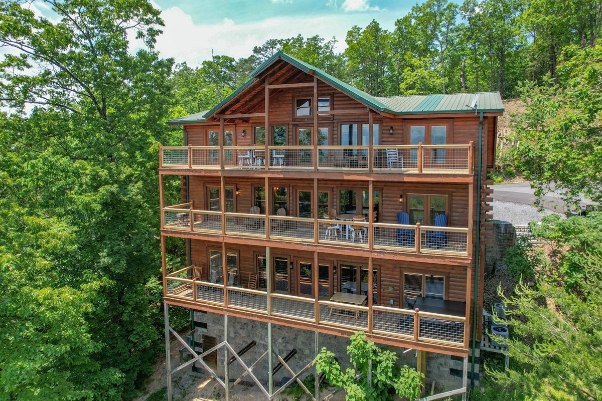Back of the House.  Boasts 3 expansive decks all with new Polywood Furniture