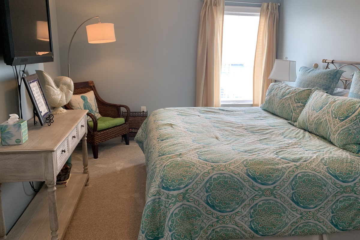 Master bedroom features a comfortable king bed.