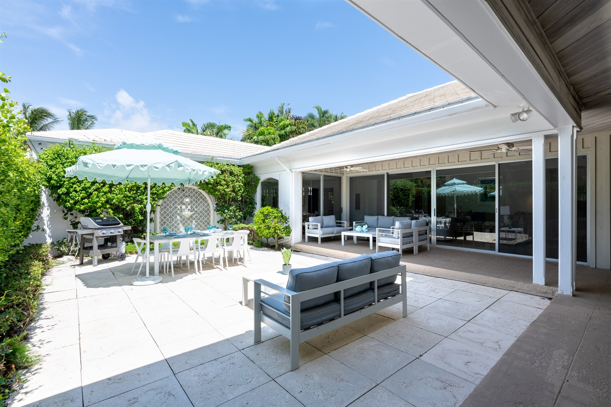 Be greeted by this open & welcoming courtyard & exquisite tiled Italian water feature, with seating for 8 under this unique Aqua blue umbrella with LED lights, large WEBER BBQ relaxing outdoor seating under ceiling fans and peaceful setting.