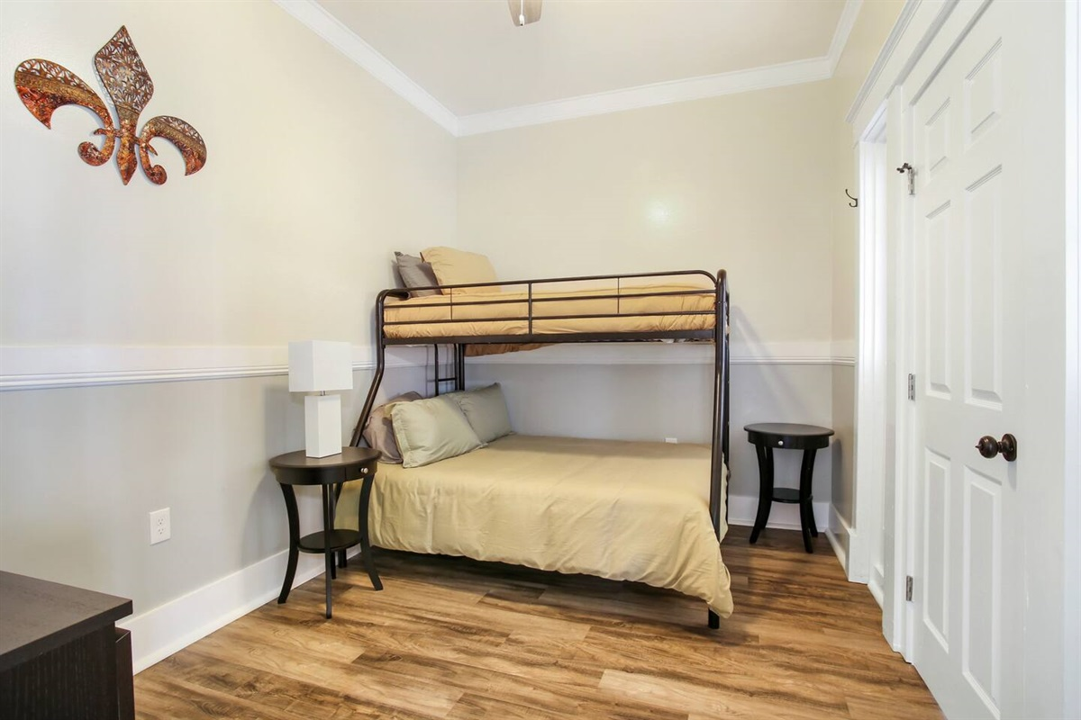 Bedroom 4. 1 twin over 1 full bunk bed, dresser, connecting door to bedroom 5.