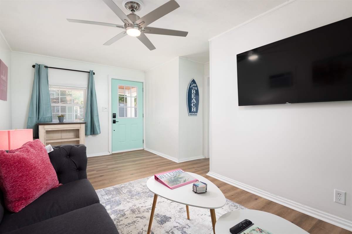 Living Room with comfy seating, an eating area and large Roku TV