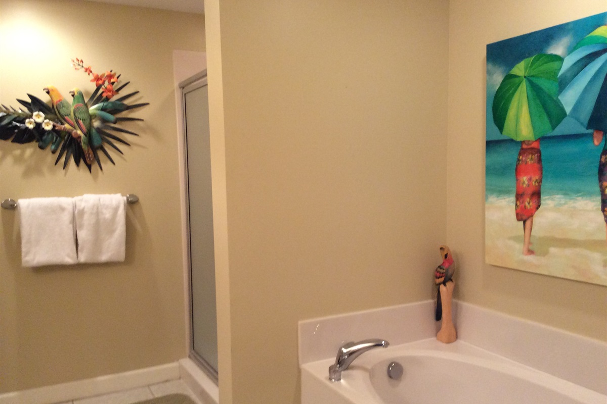 Master bath has garden tub and shower