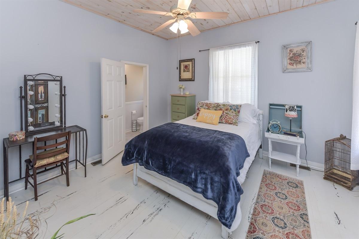 Guest bed off the den & half bath