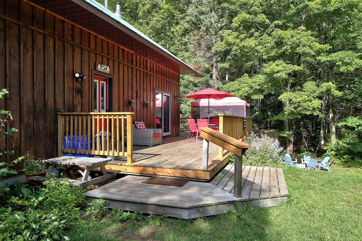 Enjoy a BBQ on the deck out in the woods!