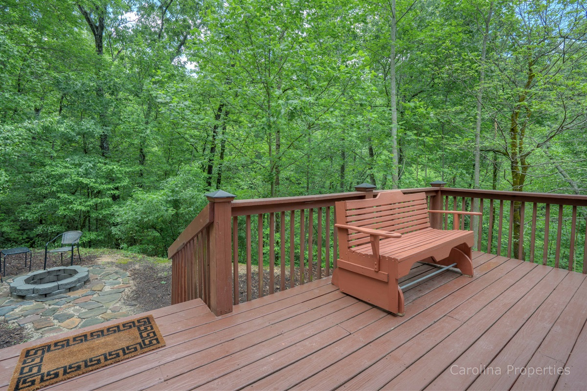 Additional view of back deck leading to fire pit