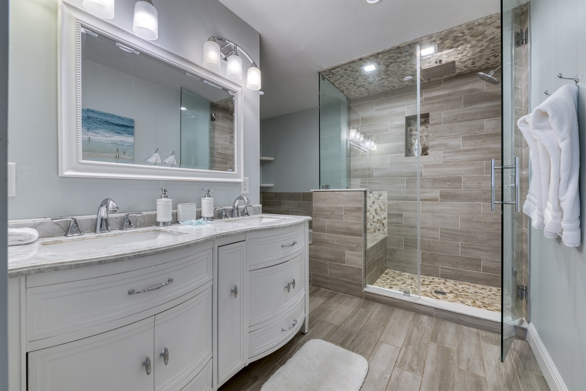 Master bedroom with double sink, walk-in shower & rain shower and jetted Jacuzzi tub.