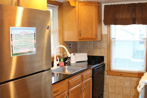 Modern kitchen with tiled floor and granite countertops