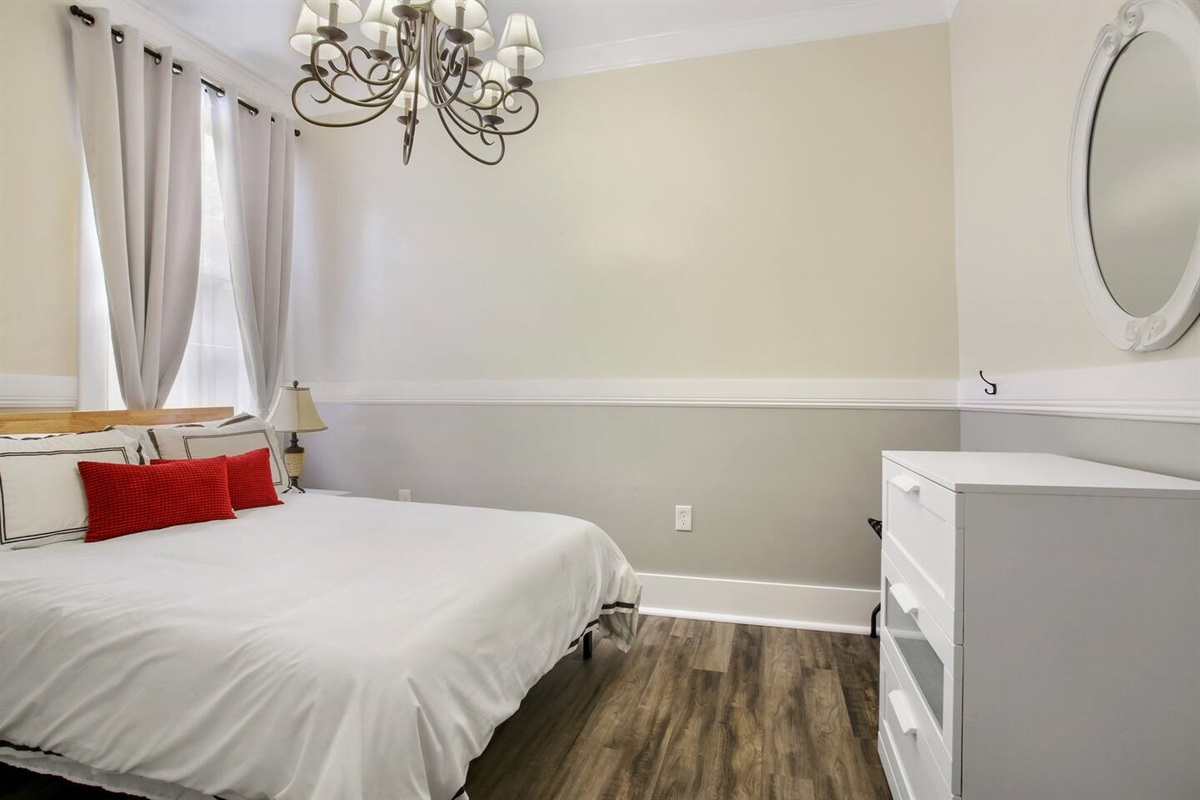 """Bedroom 3. 1 queen bed, blackout curtains, 39"""" cable tv, dresser."""