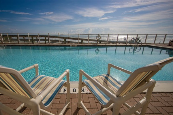 Oceanside heated pool and hot tub with new patio furniture.