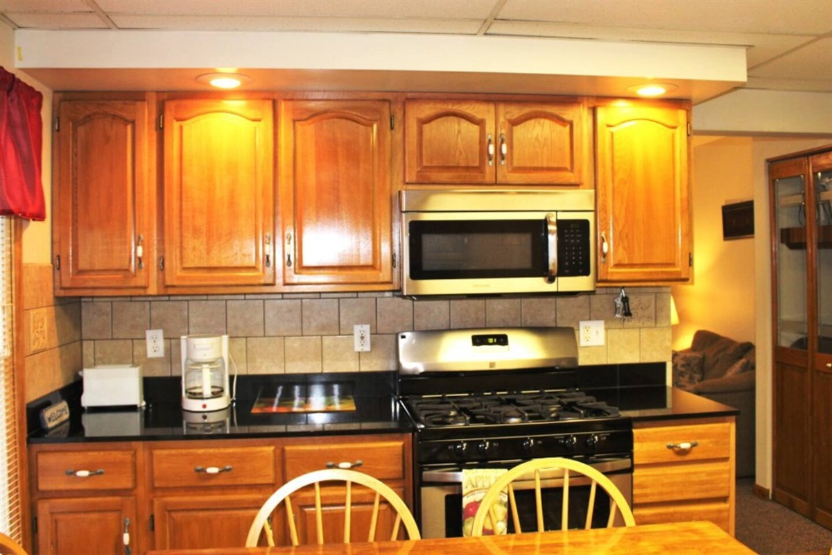 Stainless steel stove and over the range microwave