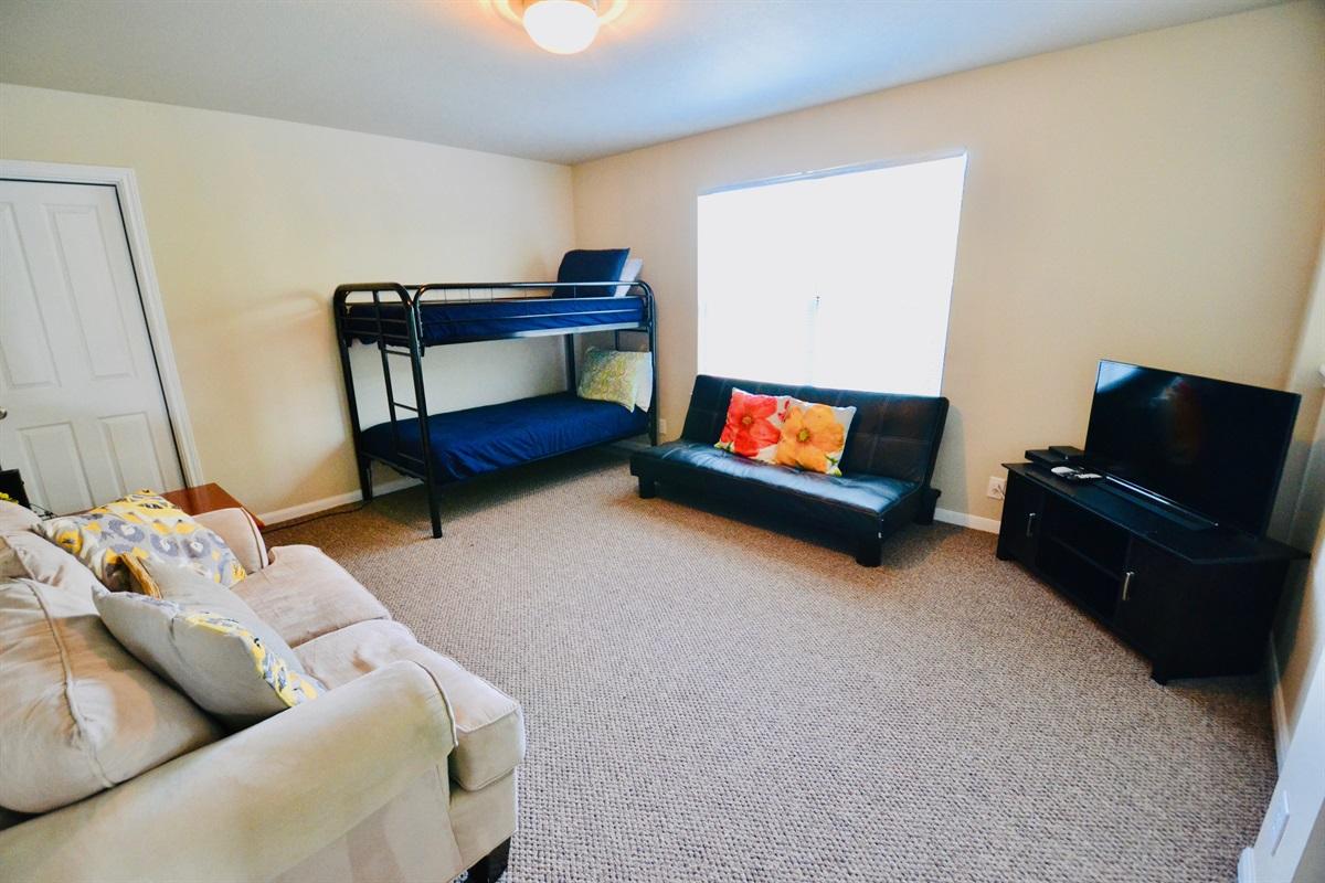 Loft/bonus room w/ TV and bunk bed