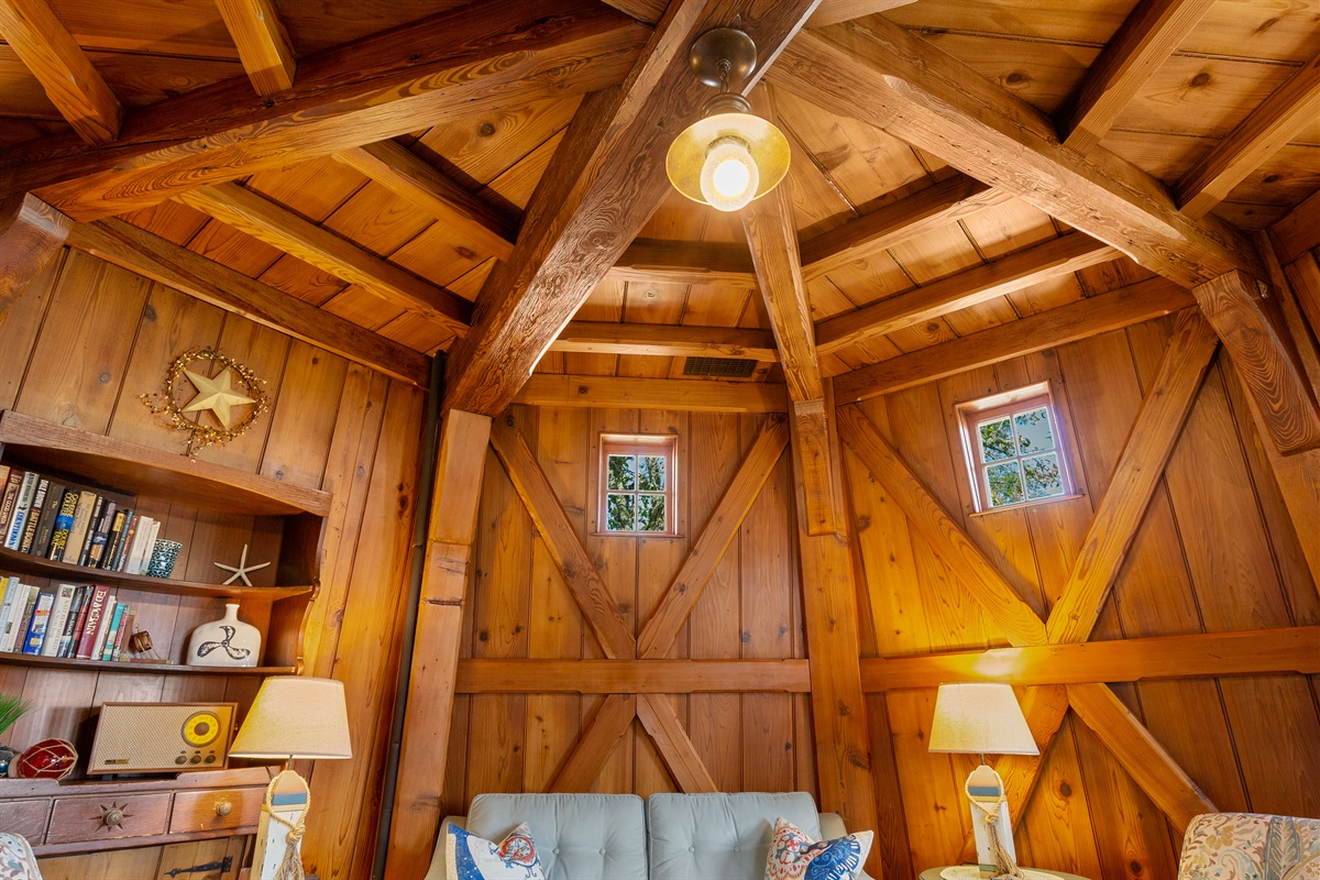 Large exposed beams reflect the rich character and design of the Windmill with cross buck walls that surround the living and dining room areas.