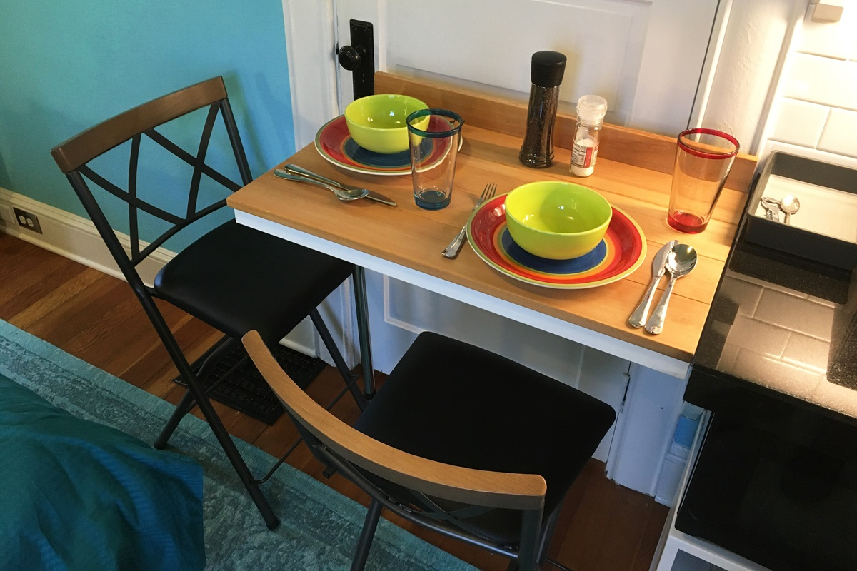 Swing-up counter and stools for your light meal or snack.