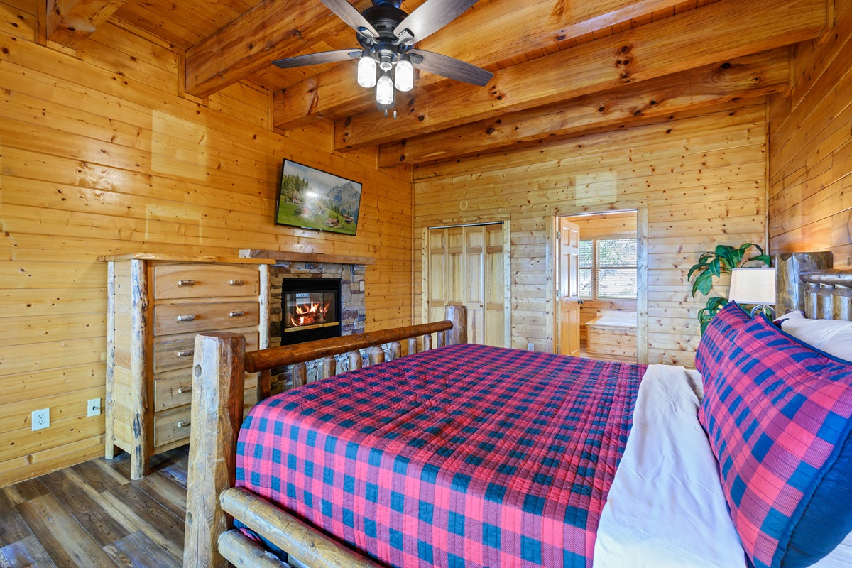 Master Bedroom with King Bed, Fireplace, 50 inch Smart TV, UPB Ports, Blackout Curtains, and On-Suite Full Bathroom with Jetted tub and Separate Shower.