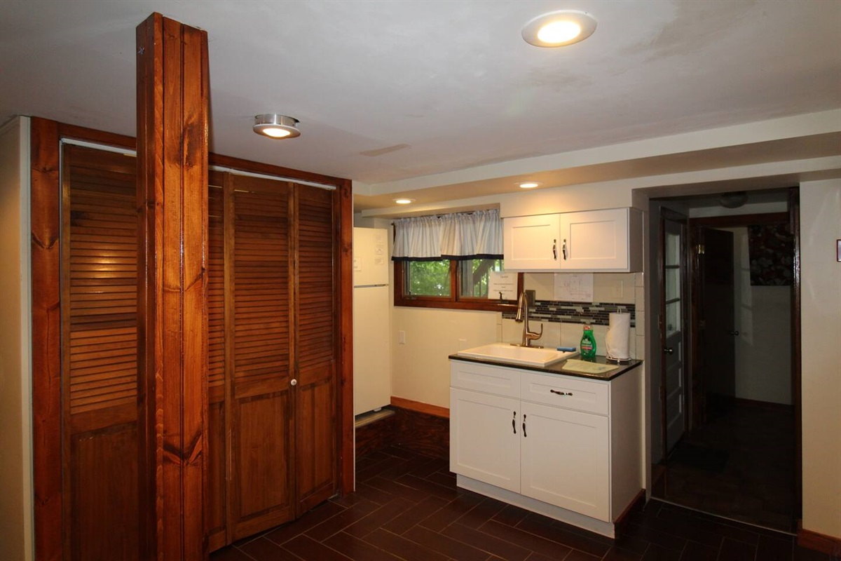 Open floor plan - kitchen area with laundry (in the bi-fold closet area)