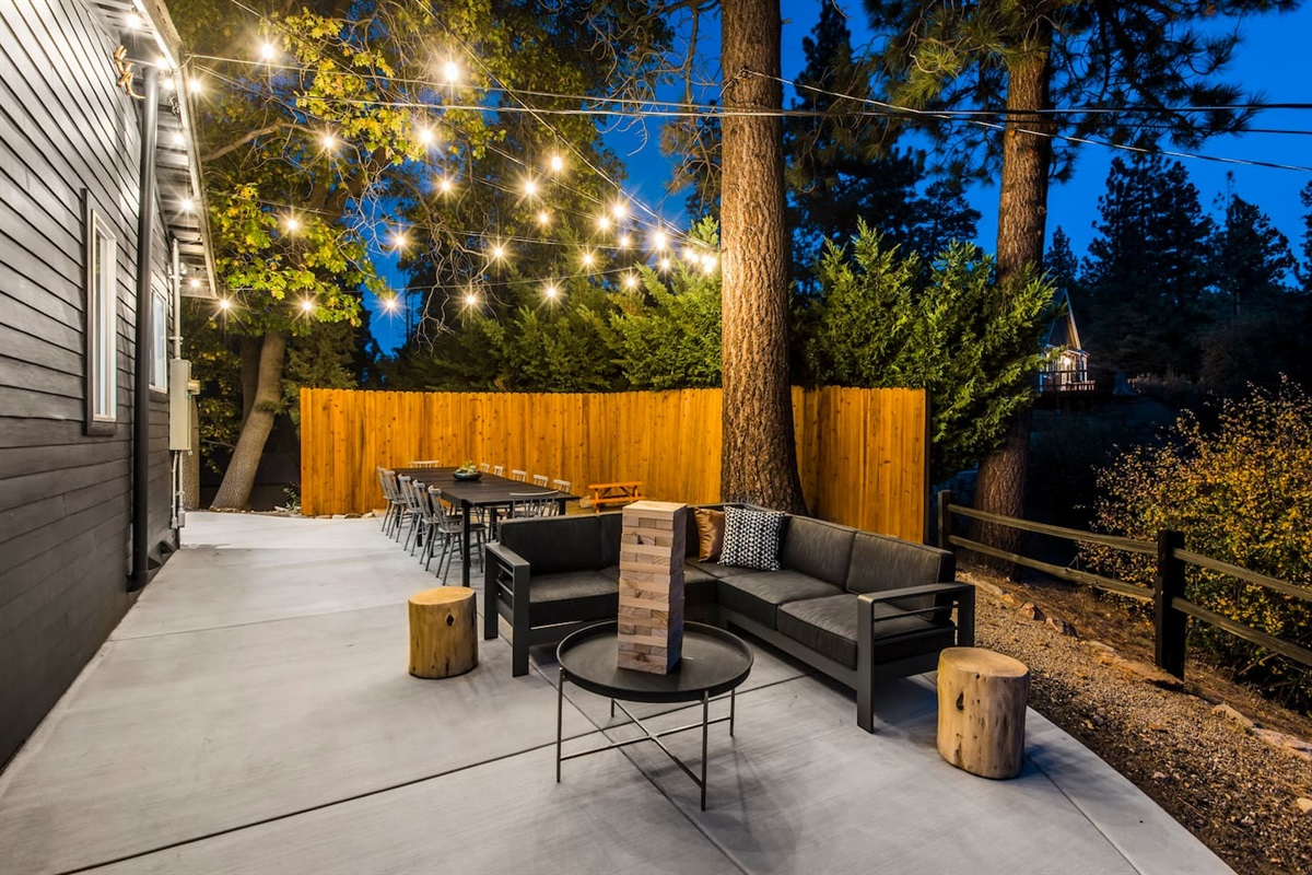 The outdoor dining area is great for meals, games, and relaxing with family and friends.