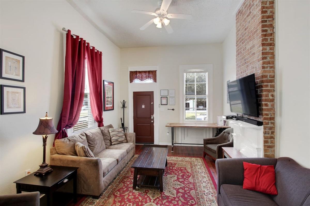 """Living room - front door, queen sleeper sofa, 55"""" cable HDTV"""