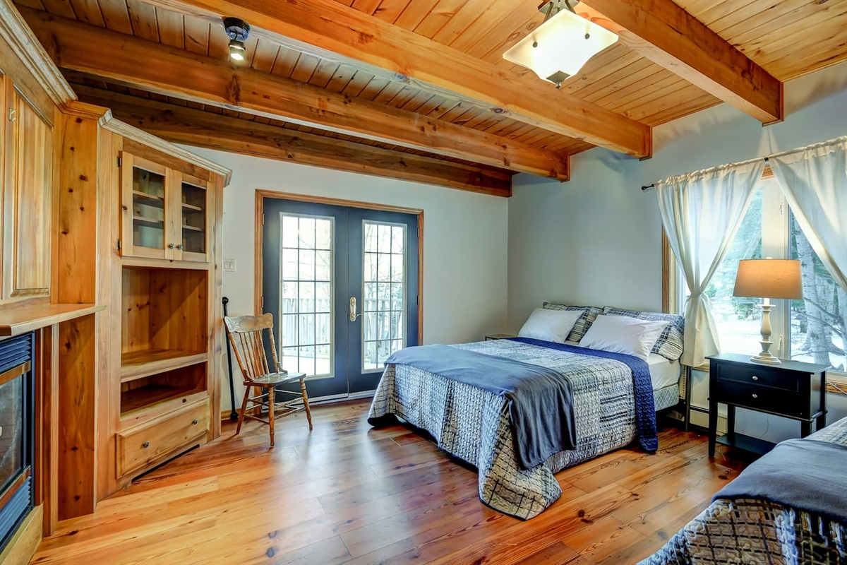 Main floor bedroom with a cozy gas fireplace, and top of the line pillow top Queen Mattress, for your comfort!