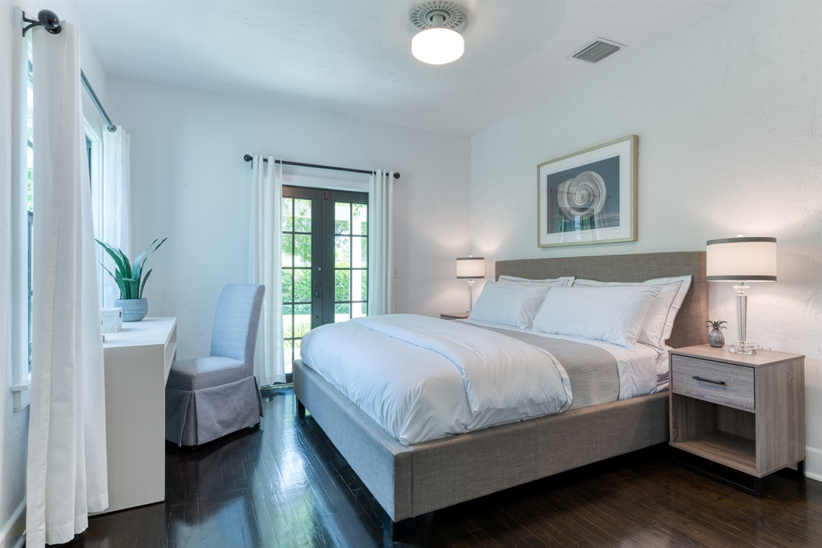 The Master Bedroom with En-suite bathroom has a King sized bed facing a large white desk & chair for those remote workers. The rich wooden floors bring out the soft creams and browns. There is plenty closet space and Smart App TV!