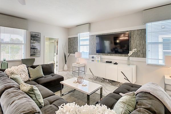 """Family Room With 75"""" Flat Screen Television"""