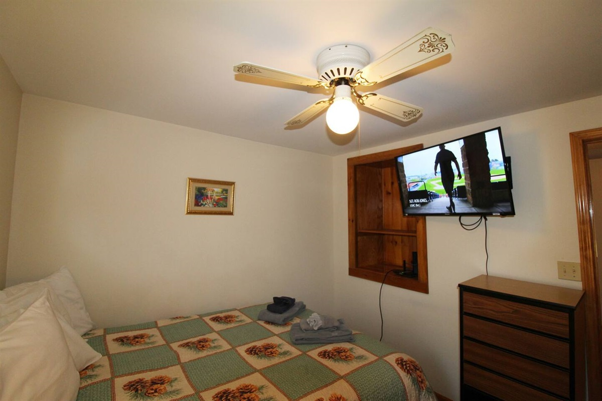 """Bedroom #2 with queen bed and 43"""" (or larger) flat screen smart Roku TV."""
