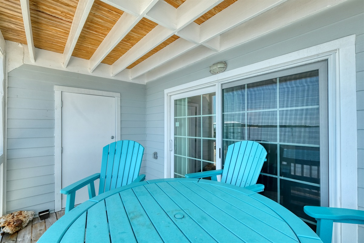 Outdoor table and chairs on private porch