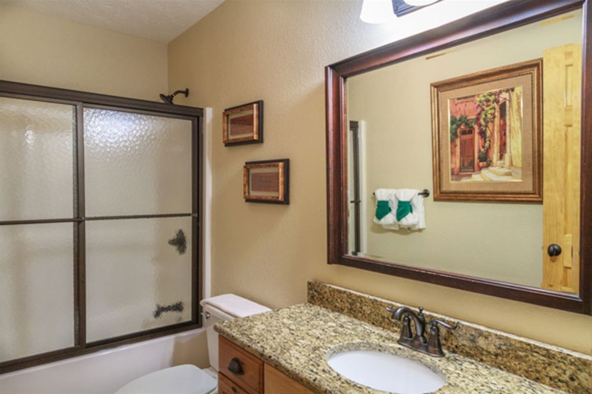 Upstairs full bathroom with shower/tub combo.