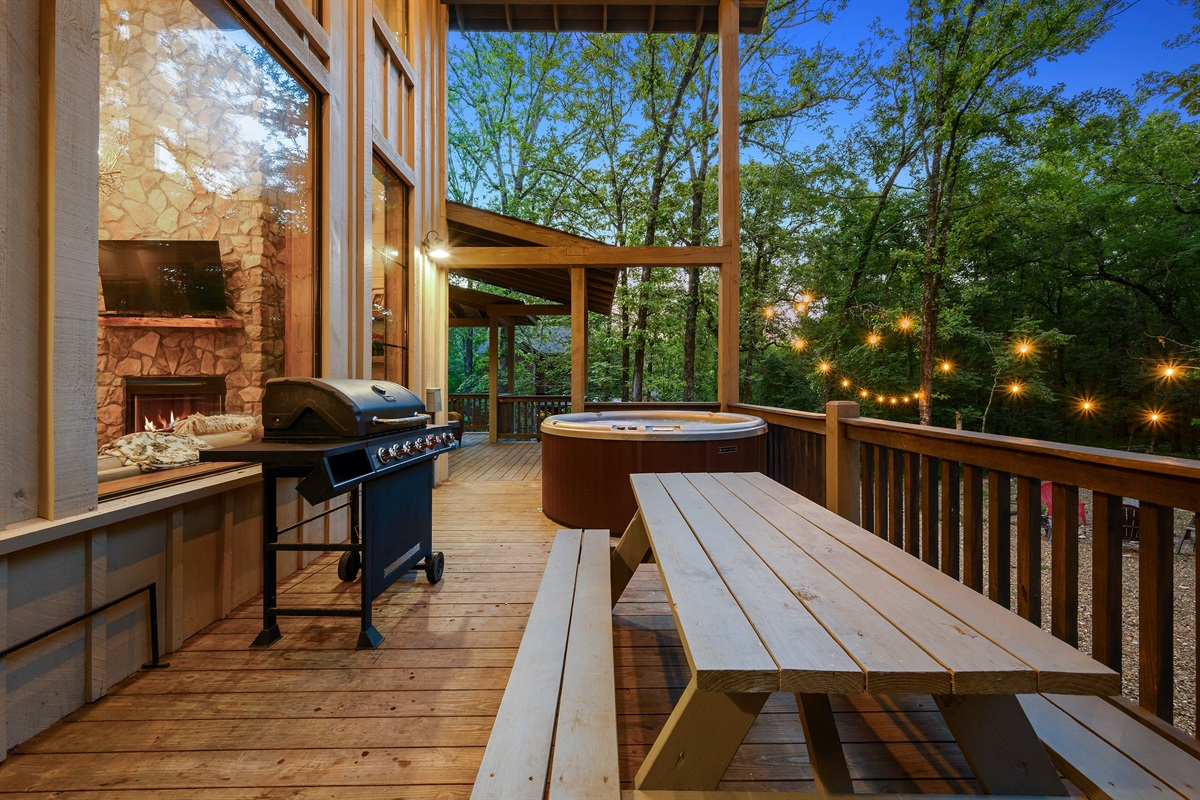 Oversized back deck with vaulted ceiling, grill, picnic table and hot tub