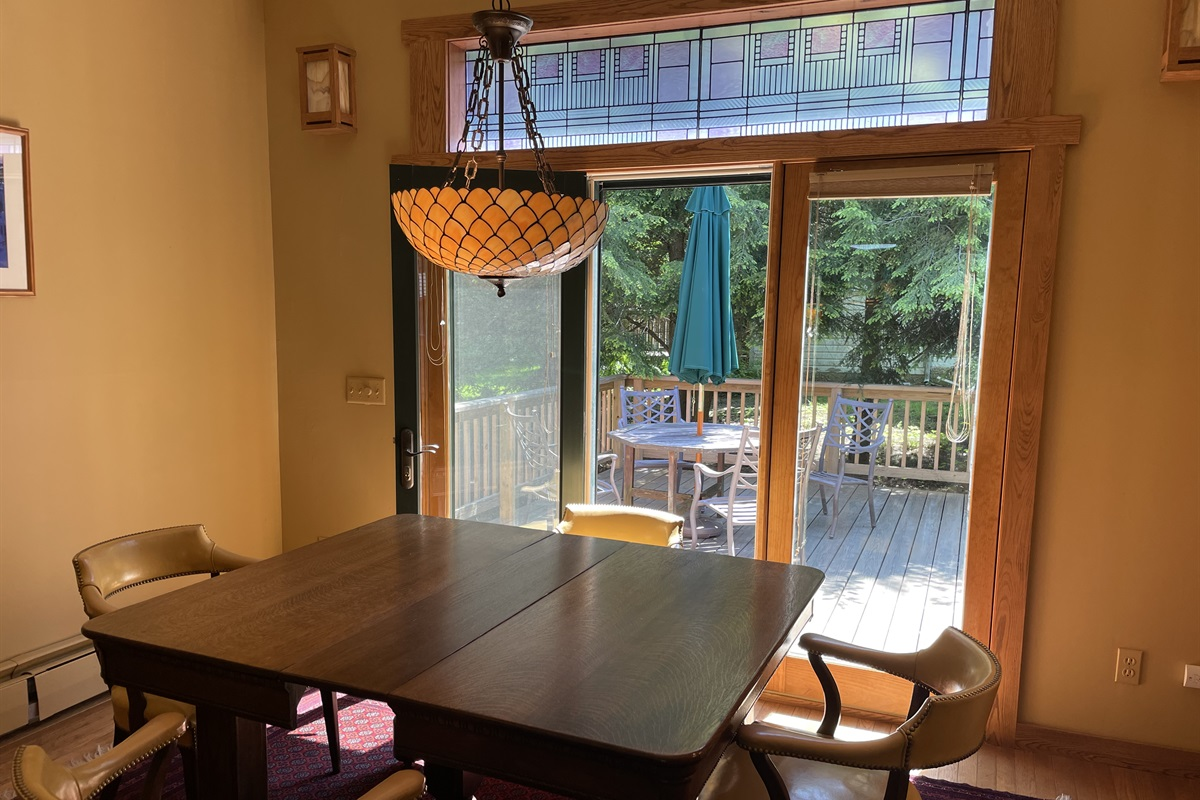 Dining Area with doors leading to the side porch.