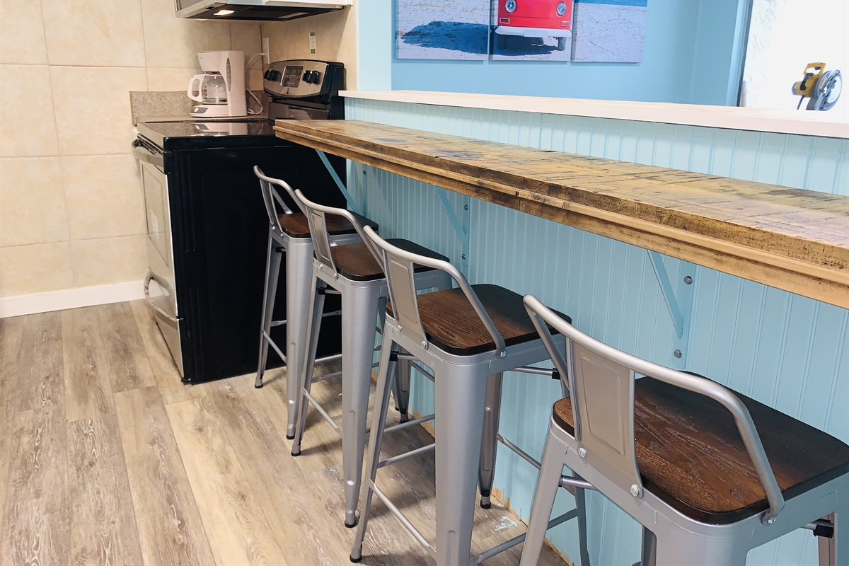 Eat Breakfast overlooking the Gulf! The bartop is part of a reclaimed train car floor!