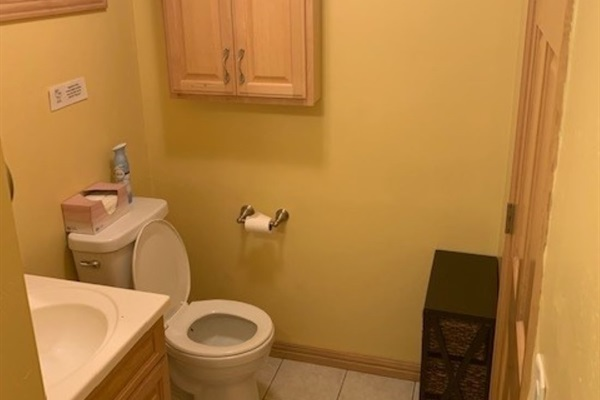 Bathroom includes toilet, sink/vanity, and a large whirlpool shower/tub.
