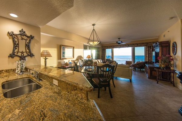 Kitchen has view of dining, living room, and the ocean!