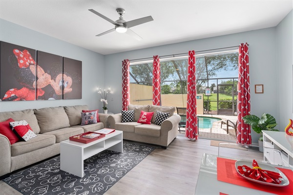 Open view format with plenty of comfortable seating. Enjoy the pool and lanai scenery along with view of the green garden!