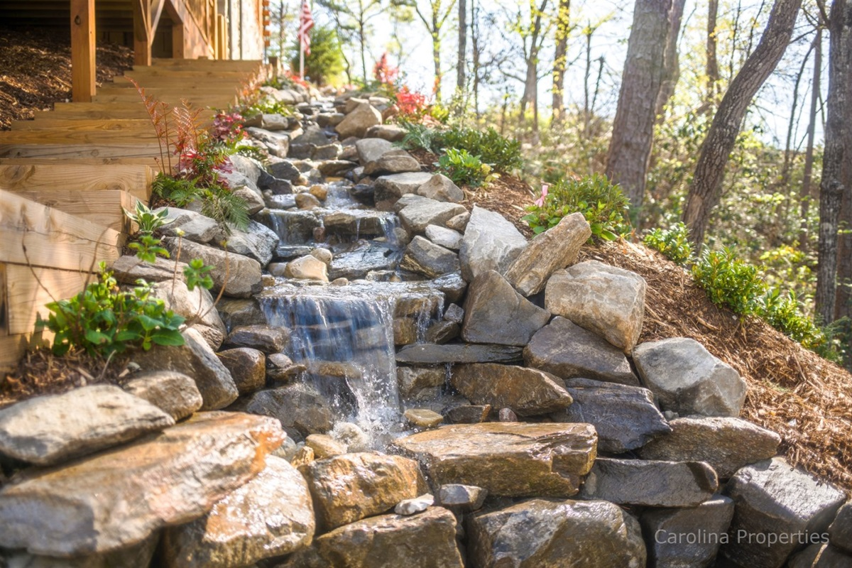 Stunning man-made waterfall feature creates a relaxing atmosphere